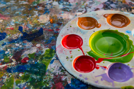 vibrant paintbrush: art palette with paint color on dry poster color texture Stock Photo