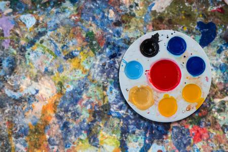 vibrant paintbrush: pallet on grunge paint poster color background