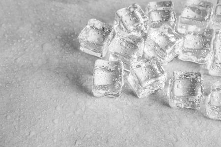 icecube: ice cube on wet floor background