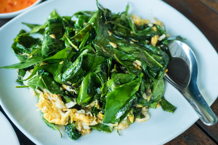 Stir fried melinjo leaves with eggs famous local food in Southern of Thailand