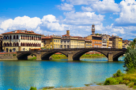 Florence or Firenze, panoramic view of the Arno River and the Ponte Santa Trinita Bridge