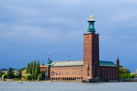 Stockholm City Hall on the shore of Malaren lake, on a cloudy day