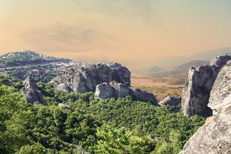 Beautiful view of rocks, mauntain and greek valley with village before storm, Meteora, Greece.