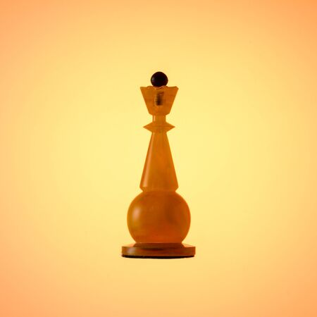 Amber chess set. Chess piece White Queen on gold gradient background.