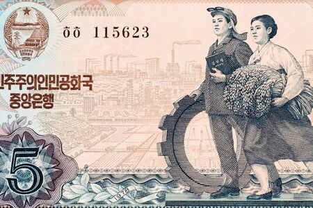 Part of old five North Korea Won banknote background. High resolution vintage photo of obverse side North Korean bill, close-up macro.