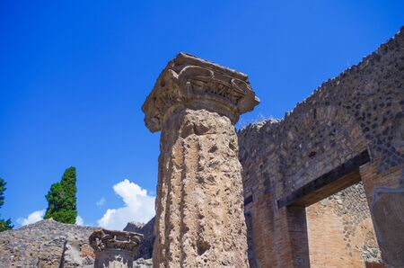 Pompeii, archeological site, ancient ruins of villa with column.