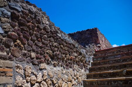 Pompeii, archeological site, Ancient ruins of dead town, walls and stairway.