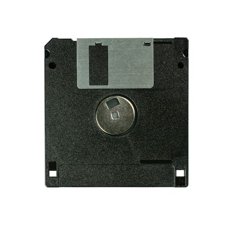 Floppy disk 3.5 inch isolated on white backround. Vintage computer diskette, top back view macro close-up.