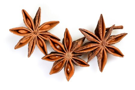 Star anise. Three star anise fruits. Macro close-up Isolated on white background with shadow, top view of chinese badiane spice or Illicium verum.