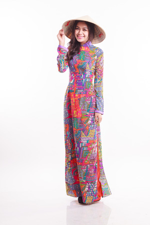 ao: Beautiful Vietnamese young woman with tradition modern ao dai and palm-leaf conical hat ( non la ) on white background