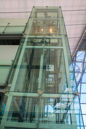 Glass lifts used for transporting people. Foto de archivo