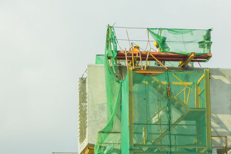 scaffolding, netting cover for construction safety. Stock Photo