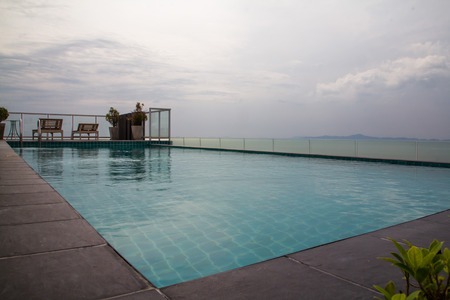 Rooftop swimming pool close to the sea.