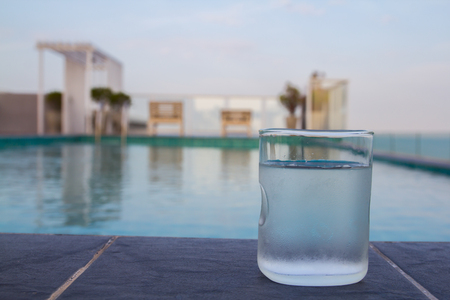 Glass of water by the pool.