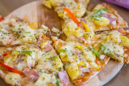Slices Of Pizza on wooden board. Archivio Fotografico