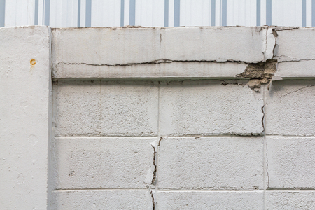 White wall with crack ,rupture and chip. Archivio Fotografico