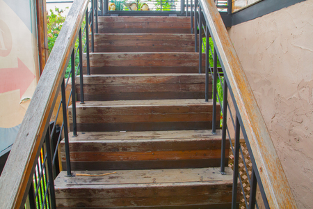 Old wooden stairs in house still strong because attendance. Archivio Fotografico - 105097633
