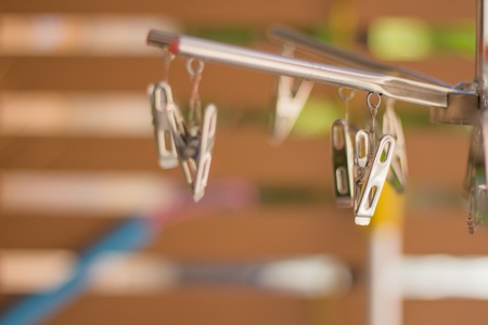 Steel clothespins clamp and blur background