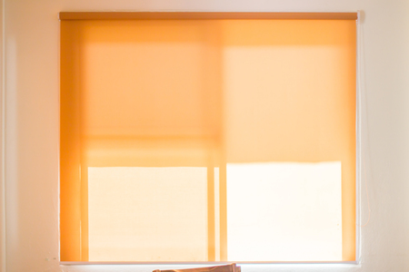 yellow roll blinds,shutter to protect sunlight. Archivio Fotografico