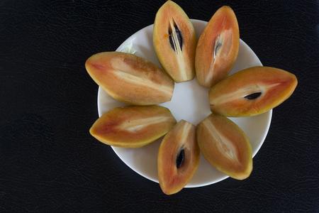 Lovelorn thai fruit on a white plate.
