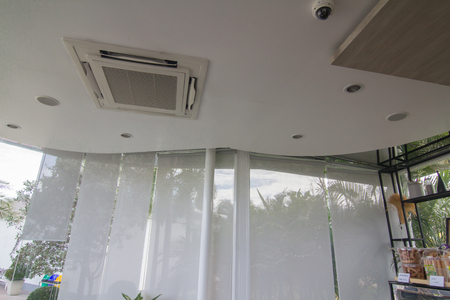 White curtain or blinds Roller sun protection and big Glass windows. Archivio Fotografico - 104550725