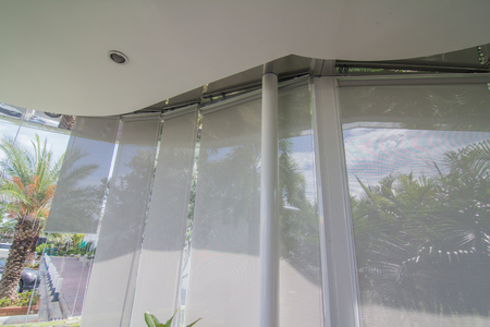 White curtain or blinds Roller sun protection and big Glass windows.