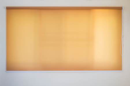 yellow roll blinds,shutter to protect sunlight. Archivio Fotografico - 104550867