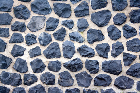 Harbour wall in Amsterdam, all made of cobble stones. Stock Photo