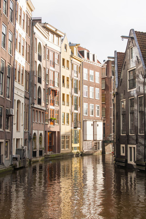 dutch canal house: Typical Amsterdam, The Netherlands canal and houses, mirrored in water