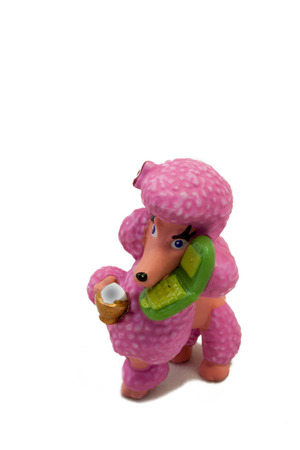 Plastic pink toy poodle on isolated white photo