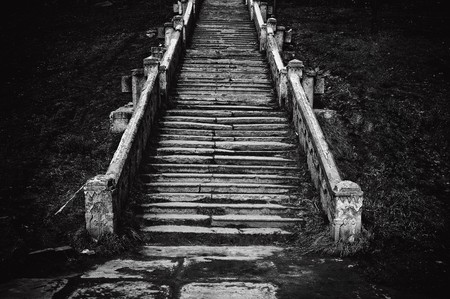 Black and white image of an old church staircase photo
