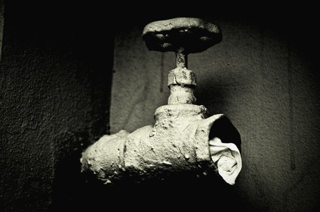 Closeup image of a sewer valve. Black and white photo, high contrast photo