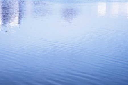 Still water background. Clear and smooth surface of river Stock Photo