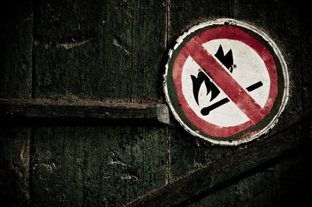 &quot,No fire&quot, sign on the wall. Grunge style Stock Photo - 8451514