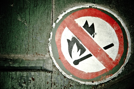 &quot,No fire&quot, sign on the wall. Grunge style Stock Photo - 8592140