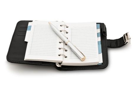 Closeup image of organizer and pen, isolated on white background photo