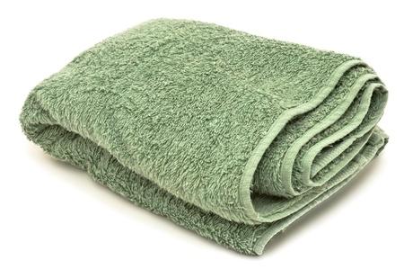 緑のタオルは、白い背景で隔離のクローズ アップ イメージ