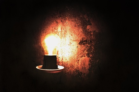 Closeup of a light bulb. Image with grunge effect Stock Photo - 8769492