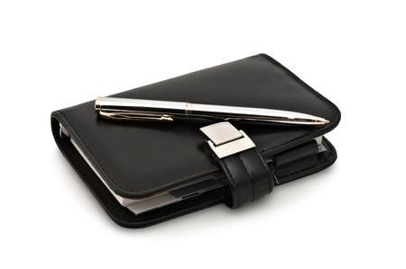 Closeup image of organizer and pen. Isolated on white background photo