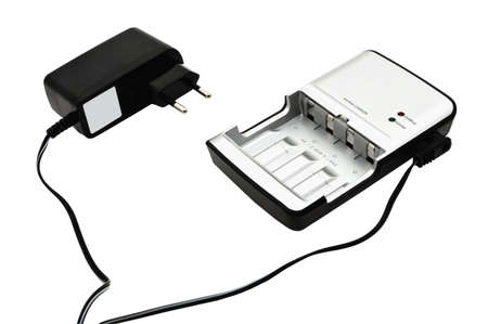 Closeup image of AAAAA accumulator battery charger, plug and cord. Isolated on white background photo