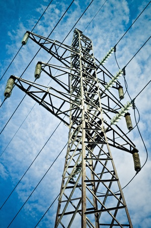 Power transmission tower against the blue sky background photo