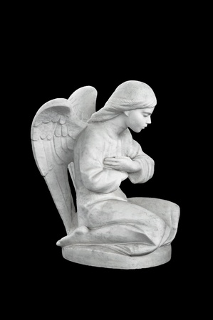 Statue of a child angel. Isolated on black background photo