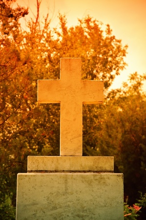 Closeup of the cross at the sunset photo