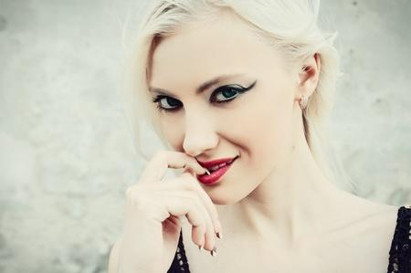Closeup portrait of seductive young woman photo