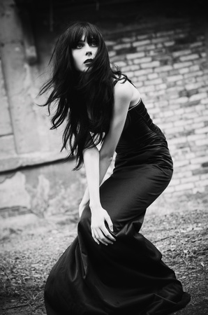 Portrait of a beautiful goth girl among the ruins  Black and white Stock Photo - 12504005