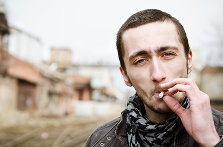 Closeup portrait of handsome smoking young man Stock Photo - 12884079