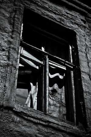 Window of abandoned house  Black and white photo in low key photo