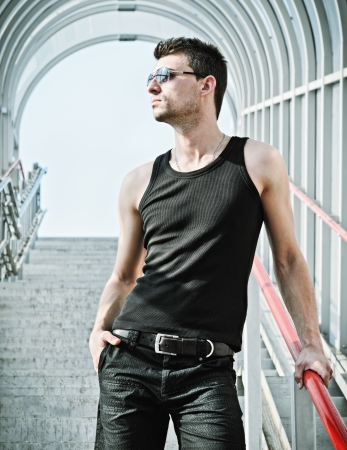 Fashion shot  portrait of a handsome young man wearing sunglasses Stock Photo