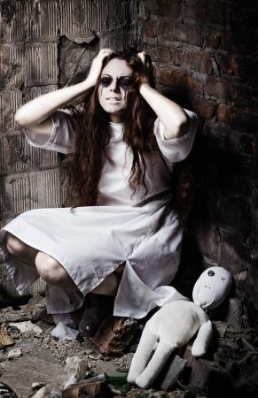 sanitarium: Horror style shot  the strange crazy girl and her moppet doll