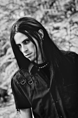 man with long hair: Portrait of  handsome young man with long hair  Black and white Stock Photo